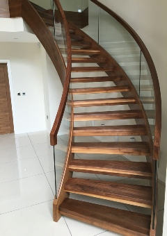 Glass staircases,glass stairs,Helical glass staircase,helical glass stairs,walnut helical staircase,walnut helical stairs: